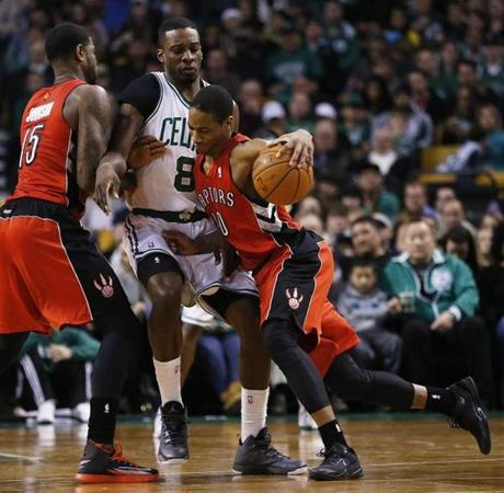Raptors forward DeMar DeRozan drove Jeff Green into a screen set by Amir Johnson.