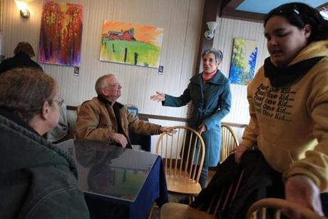 "St. Albans Mayor Liz Gamache stopped by the Cosmic Cafe and spoke with activist and longtime local pediatrician Dr. Fred Holmes, who was there with outreach workers Linda Cross (left) and Katie Tanner (right). For years, Holmes admitted, he was ""clueless"" about the opiate addictions of his patients."