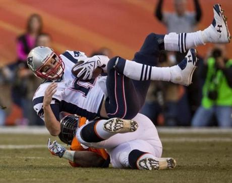 Denver CO 1/19//2014 New England Patriots Tom Brady is sacked by Denver Broncos Terrance Knighton on a 4h down and 3-yards during third quarter action in the AFC Championship Game at Sports Authority Field at Mile High on Sunday January 19, 2014. (Matthew J. Lee/Globe staff) Topic: Reporter: