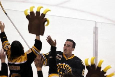 Boston Bruins Brad Marchand gives away his stick after being named the player of the game at the conclusion of the third period of play against Los Angeles Kings at TD Garden in Boston, Massachusetts January 20, 2014. The Bruins won 3-2. (Jessica Rinaldi For The Boston Globe)