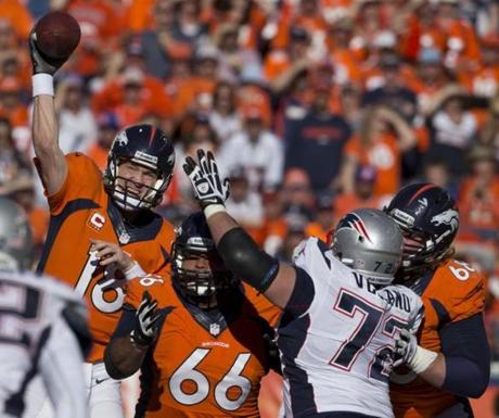 Peyton Manning completed a 12-yard pass to Montee Ball.