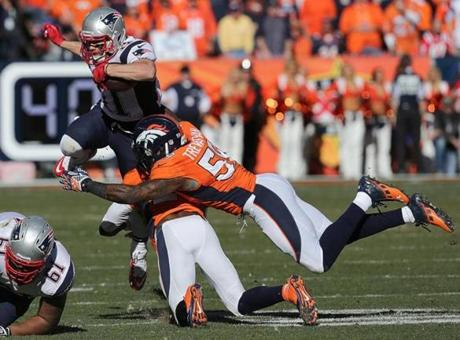 Julian Edelman had little room to run after catching this first-quarter pass. The Broncos hosted the Patriots in the AFC Championship game.