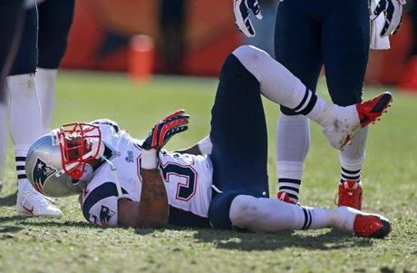 Aqib Talib grimaced in pain after he was injured in the first half. Talib had been hit by Welker.