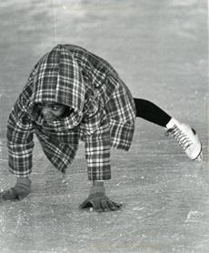 December 13, 1974:  Children from the Hernandez School in Roxbury gave ice skating a try at Melnea Cass Rink. Carla Faltine caught herself as she fell to the ice.