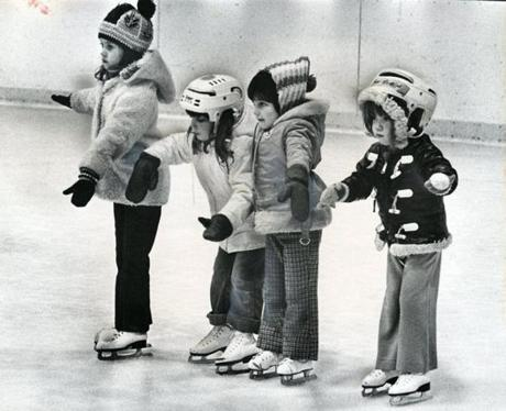 November 16, 1976: Four youngsters cautiously made their way across the ice at Sudbury rink. They are (from left), Hilary Cline, 5, of Sudbury, Lisa Schulman, 4 of Framingham and Rachel Stone and Linda Rubin, both 5 and both of Sudbury.
