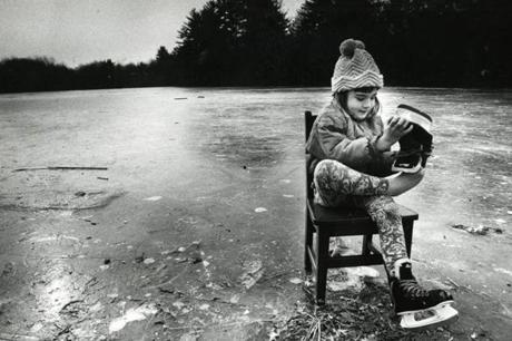 January 27, 1992:  Five-year-old Kathy Grobecker used a chair as both an aid to learn to skate and a way to comfortably take her skates off at Bodwell Pond in Salem, N.H.