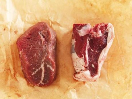 Lamb round steaks (at left), which are boneless and cut from the leg, have a slightly milder flavor than bone-in lamb loin chops (right).
