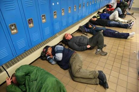 Boston- 01/23/14 The Pine Street Inn has seen an overcrowding of homeless men who have come in to escape the extreme cold. Men lay on the floor in a locker area. Boston Globe staff photo by John Tlumacki(metro)
