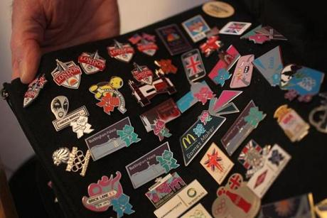 Some of his 5,000 Olympic pins in Bob Boehm's collection.