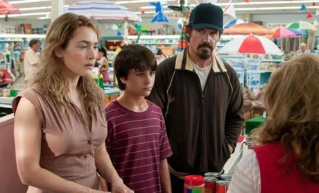 "Kate Winslet, Gattlin Griffith, and Josh Brolin in the movie ""Labor Day."""