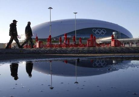 Guards walked past the Bolshoy Ice Dome at Olympic Park.