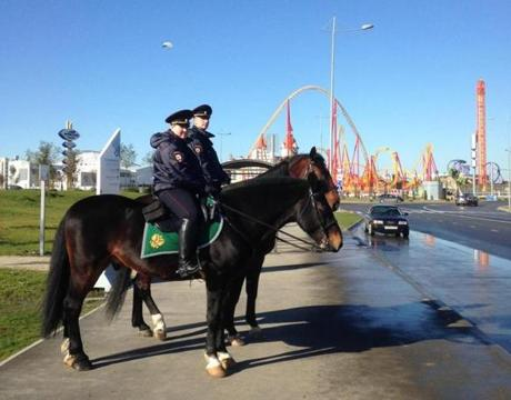 Russian officials have said the number of security personnel in Sochi could range between 40,000 and 70,000 people, but in the days leading up to the Winter Olympics the security force was understated. Above, two mounted police officers on loan from Moscow guarded a road near an unfinished amusement park.
