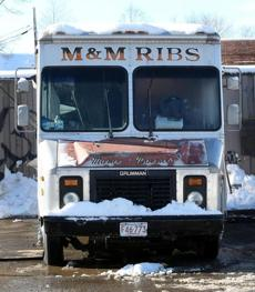The M&M Ribs truck (pictured) sells lots of barbecue, including the chicken dinner (left) with macaroni and cheese and string beans.