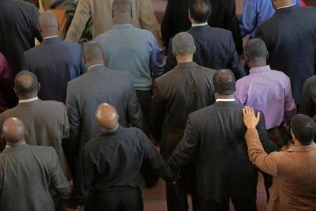 Men attending Sunday's service at Morning Star Baptist Church in Mattapan approached the front of the church for prayer.