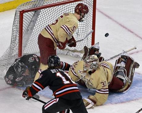The puck went  into the net behind BC goalie Thatcher Demko, but NU's Tanner Pond was in the crease courtesy of BC defenseman Michaek Matheson, who was called for a penalty, and the goal in the first period was waved off.