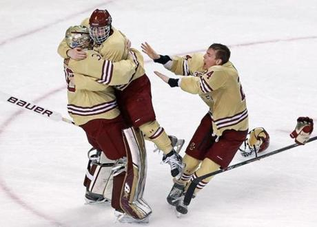 BC goalie Thatcher Demko was mobbed by teammates Teddy Doherty and Bill Arnold after the final horn sounded.