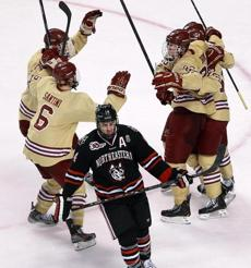 BC teammates mobbed Patrick Brown after he scored.