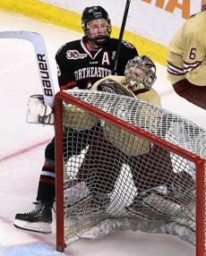 NU's Adam Reid slammed BC goalie Thatcher Demko into his net from behind in the second period. No penalty was called.