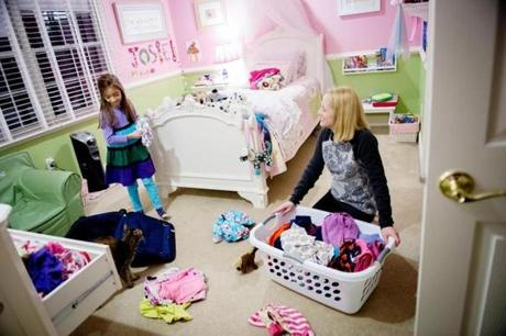 Deborah Davis and her 7-year-old daughter, Josephine, pack for a trip to Cleveland at their North Grafton home.