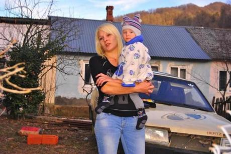 Lyuda Chertkova, with her son, Shurik, said that nothing will improve after the Games end.