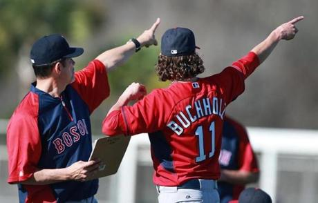 Pitching coach Juan Nieves, left, and Clay Buchholz eyed the same thing.