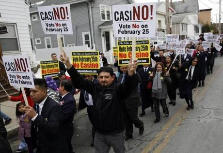 Protesters marched in opposition to a casino in Revere.