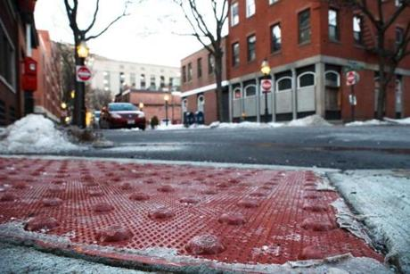 In the Bay Village Historic District at the intersection of Church and Winchester streets, pedestrian crossings have been upgraded with ramps and brick-red tactile warning strips.