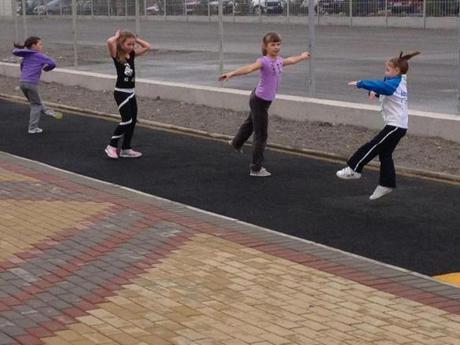 A group of girls were part of the activity at the beachfront promenade, resembling Olympic figure skaters.