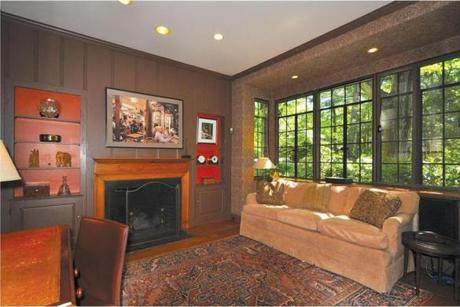 The wood-paneled library, with its bay window and slate-surround fireplace, gives only a taste of the luxury.
