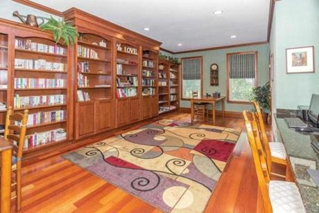 The library in this high-ceilinged 2005 Colonial was designed with children in mind.