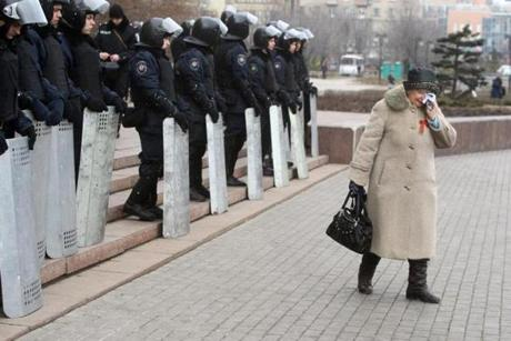 A pro-Russian activist cried as Urkainian riot police officers stood guard in front of the regional state administration building in Donetsk.