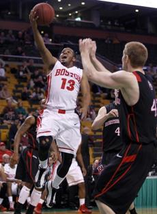 Point guard D.J. Irving (above) persuaded former AAU rival Maurice Watson to join him at BU even though they play the same position.