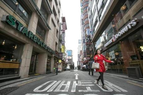 Both Dunkin' Donuts and its competitor Starbucks consider South Korea a warm-up for an even bigger play: China. Pictured: A street in Seoul.
