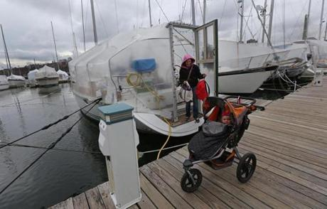 Sarah Garant, her  husband, Herve (not shown), and their 20-month-daughter Maya live on their sailboat Jessica at Constitution Marina in Charlestown -- even in winter.