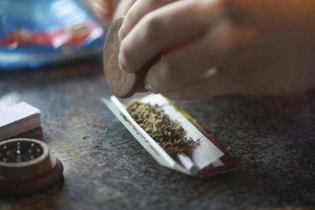 A visitor rolled a marijuana joint in a coffee shop in the Netherlands.