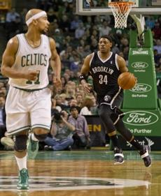 Pierce dribbled up the court behind Bayless.