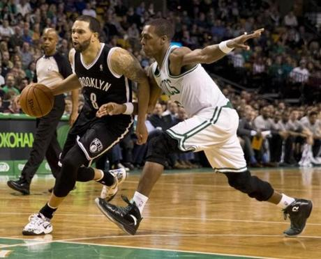 Deron Williams drove to the basket past Rondo.