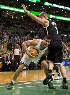 Kris Humphries looked for his shot under pressure from Mason Plumlee.