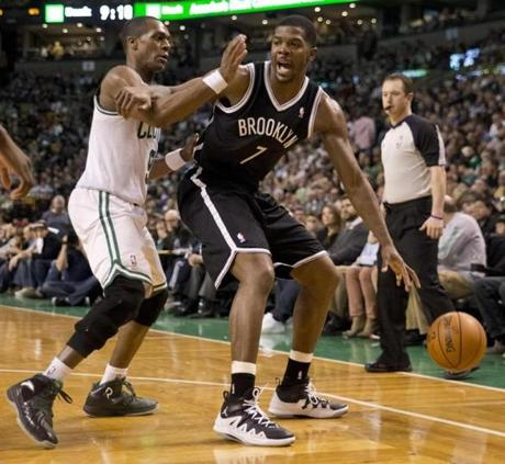 Rondo put defensive pressure on Joe Johnson in the third quarter.