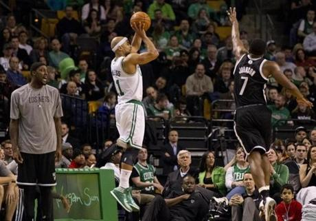 Bayless knocked out a 3-pointer under pressure.