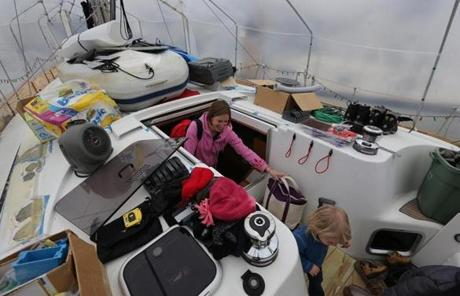 Sarah Garant and her family live year-round on their sailboat, which is covered in plastic during the cold months.