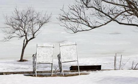 Although Lake Quannapowitt  in Wakefield still appeared frozen, buds on trees and snow melting under a pair of chairs showed some signs of spring.