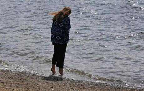 Claire Rypkema stuck her toes in the frigid waters at Pleasure Bay in South Boston. She was on spring break from Illinois State University with fellow students.