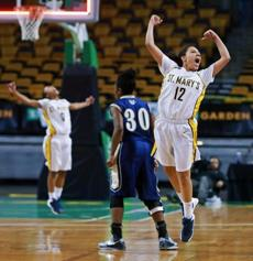 As the final buzzer sounded, St. Mary's Nichole Rudolph (12, right) and Sharell Sanders (10, backround left) leaped in celebration. Archbishop Williams' Leah Spencer (30) did not. The teams met  in the girl's Division 3 State Semi Final at the TD Garden.