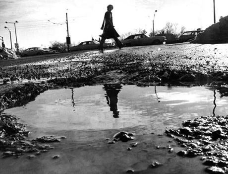 January 30 1978: This pothole resembled a refelcting pool at the corner of University road and Commonwealth avenue in Boston.