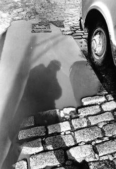 March 6 ,1969: A pedestrian is silhouetted in this pothole on Hampden street in Boston.