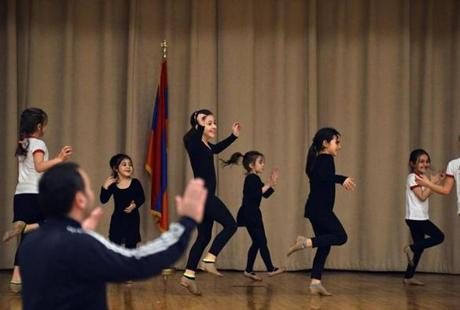 Folk dancer instructor Arman Mnatsakanyan led rehearsal of members of the Erepuni Dance Group at the St. Stephen's Armenian Elementary School for a June 22 presentation at Newton North High School.