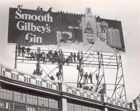 October 2 1978 / fromthearchive / Globe Staff photo by George Rizer / Sox fans gathered on the billboard structure to wait for the start of the Red Sox-Yankee sudden-death playoff game. Every fan probably wanted a gin when Bucky Dent hit a three-run home in the top of the seventh inning to put the Yankees ahead 3-2. The final score would eventually be 5-2 as the Yankees won the American League East.