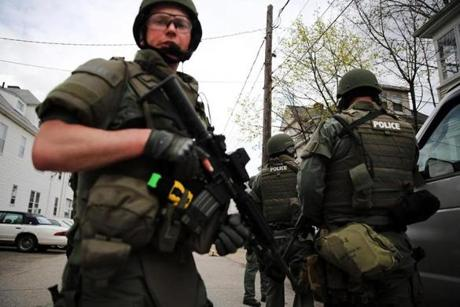 A SWAT team conducts a door-to-door search for suspect Dzhokhar Tsarnaev.