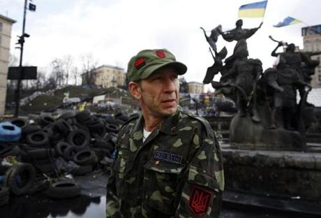 Kiev, Ukraine-- 03/20/2014-- A member of the Ukrainian Nationalist group Right Sector Aleksandr Kononko, 39, of Kiev looks over his shoulder as he stands beside the spot in Maidan where he was injured during the fighting and protests that took place there in Kiev, Ukraine March 20, 2014. Jessica Rinaldi/Globe Staff Topic: 21Kiev01